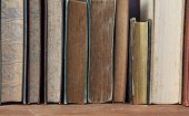 antique books on wooden shelf.