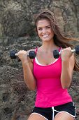 Young Woman With Hands Weights By Rock Formation