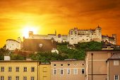 Hohensalzburg Castle in city centre of Salzburg at sunset, Austria
