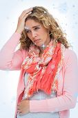 Composite image of Blonde woman having both headache and belly pain with snow falling