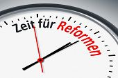 An image of a typical clock with text time for reforms in german language