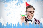 Geeky hipster in party hat with horn against frost and fir trees