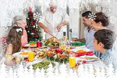 Extended family at dining table for christmas dinner against fir tree forest and snowflakes