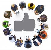 Diverse People Using Digital Devices with Thumbs Up Symbol