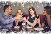 Friends clinking red wine glasses at a bar against fir tree forest and snowflakes