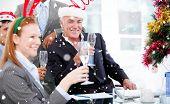 Composite image of Businessman team celebrating christmas against snow falling