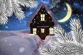 Composite image of christmas house against aurora night sky in blue