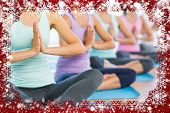 Composite image of snow frame against yoga class in gym