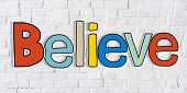 Believe Word and Brick Wall in Background