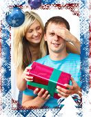 Woman giving a present to her boyfriend against christmas themed frame