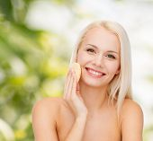 health, beauty and spa concept - beautiful woman with sponge