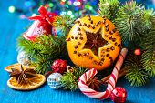 stock photo of christmas spices  - Oranges pierced with cloves - JPG