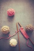 Balls of wool on wooden background, old retro vintage style