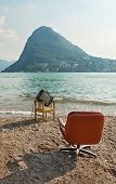 vintage decor on the lake shore, armchair and television