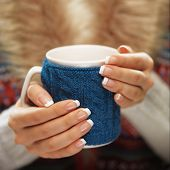 foto of nail-design  - Woman holds a winter cup close up - JPG