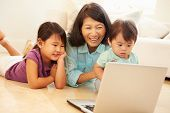 Grandmother And Grandchildren Using Laptop Together