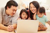 foto of watching movie  - Family Watching Movie On Laptop At Home - JPG