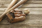 Old Baseball, Mitt And Bats On Rough Wood Surface
