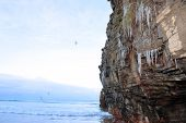 Icicles Thaw On A Cliff Face