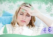 Sick woman with headache lying on the sofa in the livingroom against snowflakes and fir tree in green