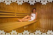 Calm brunette relaxing in a sauna against snowflake frame