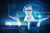 The word virus alert and businesswoman holding hand out in presentation against blue technology interface with dial