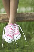 Girl's legs and pink shoes