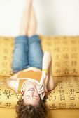 Woman talking on cell phone while laying upside down