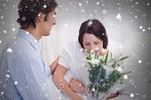 Composite image of man brought flowers to his girlfriend in the hospital against snow falling