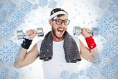 Geeky hipster lifting dumbbells in sportswear against snowflake frame