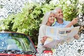 Composite image of snow frame against cheerful mature couple reading map looking for direction