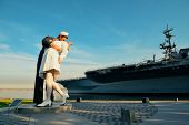 San Diego, CA - MAY 18: Unconditional Surrender sculpture at sea port on May 18, 2014 in San Diego. By Seward Johnson, the statue resembles the photograph of V-J day in Times Square