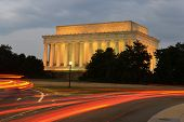 Lincoln Memorial at night with trailing car lights foreground - Washington DC, United States