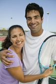 Mixed doubles Tennis Players on tennis court portrait