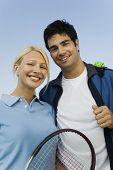 Mixed doubles tennis players portrait with racket