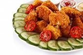 Fried chicken nuggets and vegetables