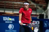 SEPTEMBER 25, 2014 - KUALA LUMPUR, MALAYSIA: Leonardo Mayer of Argentina makes a backhand return in his match at the Malaysian Open Tennis 2014. This is an ATP sanctioned tournament.