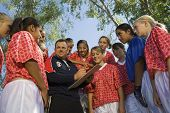 image of pep talk  - Male Coach with young girls - JPG