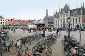 BRUGES, BELGIUM - SEPTEMBER 6, 2014. The houses of the Grote Markt square on September 6, 2014.  The historic city centre of Bruges is a prominent World Heritage Site of UNESCO