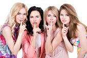 Group of young beautiful women with silent sign posing at studio over on white background.