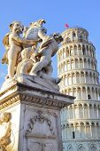 The statue of angels on Square of Miracles in Pisa and Leaning Tower, Italy