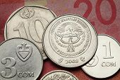 Coins of Kyrgyzstan. National emblem of Kyrgyzstan depicted in Kyrgyzstani som coins.