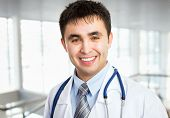 Portrait of friendly male doctor smiling
