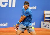 BARCELONA - APRIL, 24: Spanish tennis player Rafa Nadal in action during a match of Barcelona tennis tournament Conde de Godo on April 24, 2014 in Barcelona
