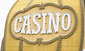 Antique Casino Sign with Lights on Building.