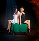 Angel and devil on the table