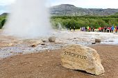 Iceland - Strokkur geyser. Sign showing the famous Icelandic tourist attraction and landmark on the Golden Circle.