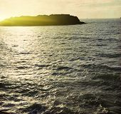 Photo of seascape at sunset in vintage style.