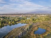aerial view of Cotton Hollow, one of natural areas in Fort Collins, Colorado along the Poudre River converted from a gravel quarry