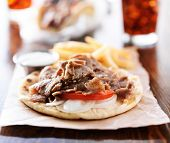 open greek gyros with fries and cola